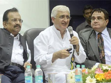 Union Minister of Water Resources and Minorities Affairs, Salman Khurshid, speaking at a function; Moosa Raza, Chairman SIET Trust on extreme left