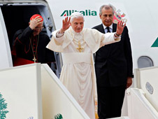 Pope Benedict XVI, standing next to Lebanese President Michel Suleiman, waves to the crowd at Rafik Hariri International Airport in Beirut, Lebanon, Friday. The pope urged peace during a time of great turmoil in the Middle East.