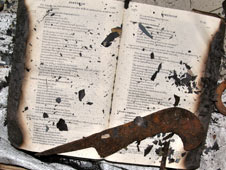 Charred Bible and blade. The blade was commonly used in the 2008 attacks on Christians in Kandhamal, Orissa