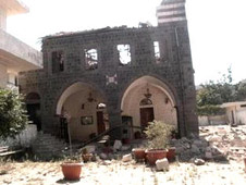 A destroyed church building in Homs, Syria