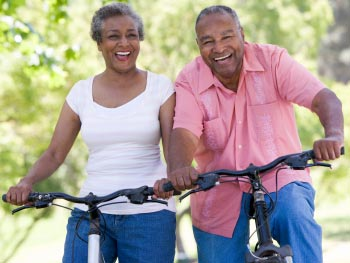 An old couple cycling together