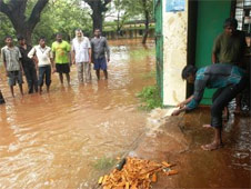 A man trying to clear the flood waters from his home