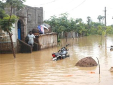 A vehicle submerged in the flood waters