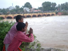 Children beseeching the flood waters to reside