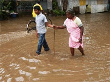 The helpless look of a man in the midst of a flooded area