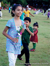 A girl found jubilant after recieving the Rose twig, at Mananchira square ground