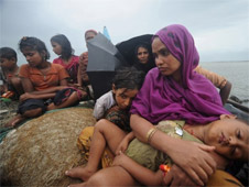 This file picture taken on June 13, 2012 shows Rohingya Muslims in an intercepted boat in Teknaf, trying to cross the Naf river into Bangladesh to escape sectarian violence in Myanmar