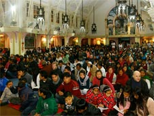Christians praying in a church in Nepal