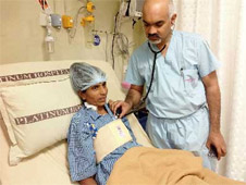 Meena Koli with Dr Bijoy Kutty at the Mulund hospital where she is recovering