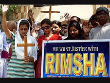 Pakistani Christians hold crosses during a September 2012 protest against an Islamic cleric who accused a Christian teenager of blasphemy.