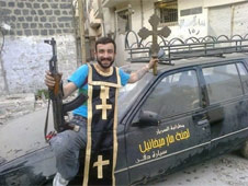 An opposition fighter mocks Christians in a sinister pose