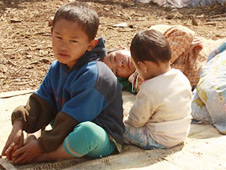 Frightened and exhausted, Kachin people at a refugee camp