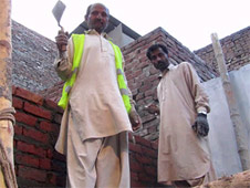 Reconstruction work on the Christians' homes is underway