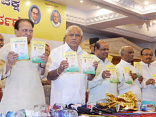 B S Yeddyurappa and his party colleagues during the launch of elections manifesto