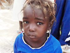 Malian child whose Christian family was displaced by the Islamist takeover