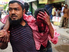 A man carries an injured Islamist protester injured during clashes with police on Sunday