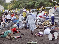 Wounded churchgoers lie on the ground as Roman Catholic nuns run for cover after a blast at the St. Joseph Mfanyakazi Roman Catholic Church in Arusha, Tanzania
