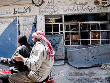 Buildings in the centre of al-Qusair have been damaged or destroyed
