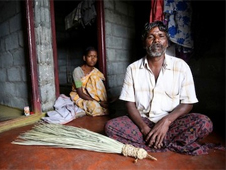 A tribal woman who lost three infants during delivery, with her husband in Vellakulam