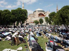 Turkish Muslims pray near Hagia Sophia, demanding it be turned into a mosque.