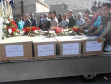 A humble funeral procession for some of the Christians killed in Saddad