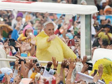 Pope Francis greets worshippers